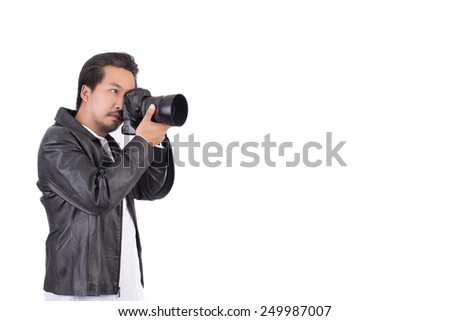 asian photographer in action isolate on white background - stock photo