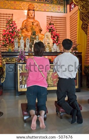 Asian praying in a temple. - stock photo