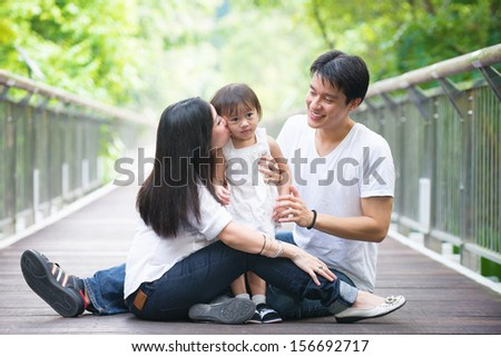 asian pregnant mother and family outdoor photo  - stock photo