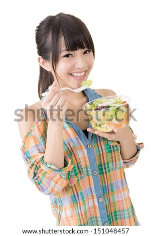 Asian pretty woman eats salad. Close up portrait. Isolated on the white background. - stock photo