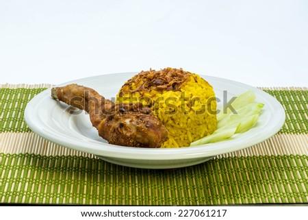 Asian's favourite dish : Chicken biryani with yellow rice - stock photo