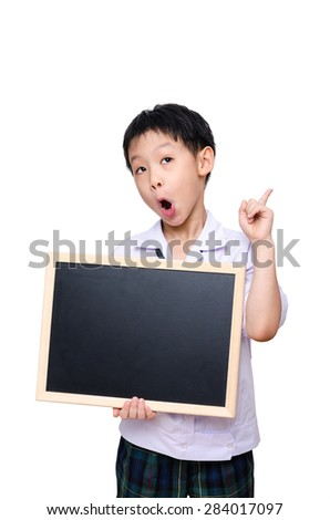 Asian schoolboy in uniform holding chalkboard over white backgroound - stock photo