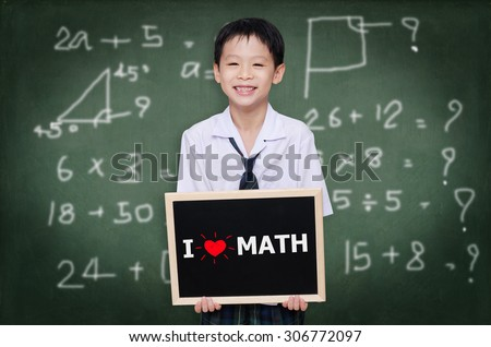 """Asian schoolboy in uniform holding chalkboard with text """"I Love Math"""" - stock photo"""