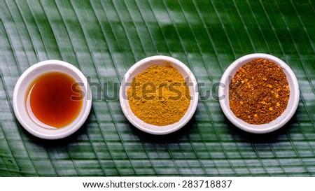 Asian seasoning on banana leaf - stock photo