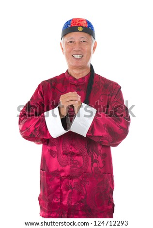 asian  senior chinese man celebrating lunar new year, with traditional clothing - stock photo