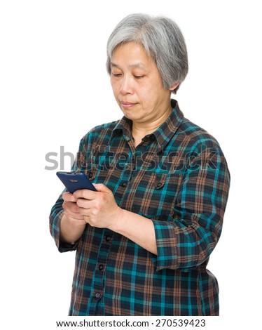 Asian senior female with mobile phone  - stock photo