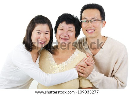 Asian senior mother and adult offsprings over white background - stock photo