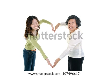 asian senior woman and daughter making the sign of love, isolated on white background - stock photo