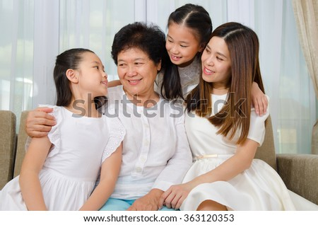 Asian senior woman and her daughter and granddaughters - stock photo