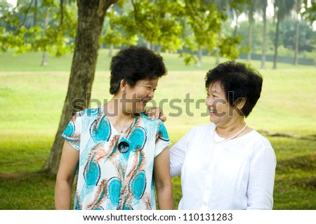 asian senior women having conversation - stock photo