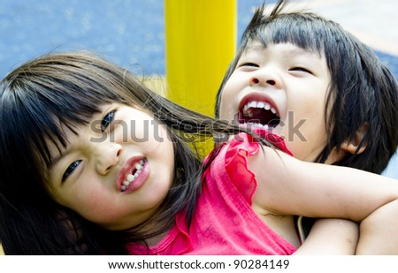 Asian Sibling, brother and sister play wrestling - stock photo