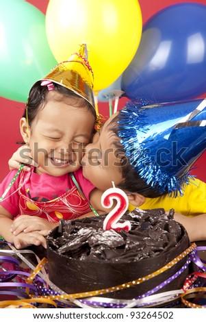 Asian sibling celebrating second  birthday - stock photo