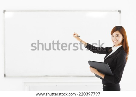 asian smiling business woman teaching with a white board.isolated on white backgroun - stock photo