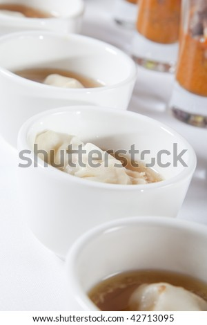 Asian soup with dumpling - stock photo