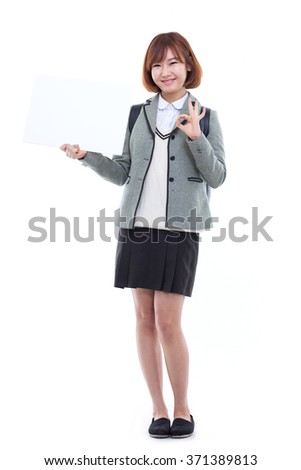 Asian student girl showing banner isolated on white background. - stock photo