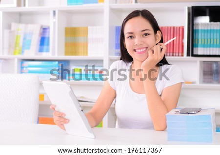 Asian student happy with learning by Computer tablet - stock photo