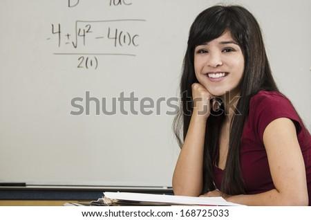 Asian student in classroom/Brilliant Asian Student/Young attractive Asian student in classroom setting - stock photo