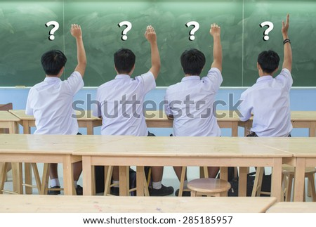 Asian Students in uniform  answering with question-mark - stock photo