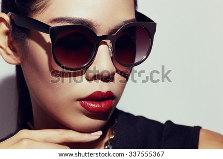 Asian style black hair model with sunglasses close up portrait in the studio