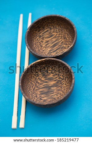 Asian style: bowl and chopstick on the table - stock photo