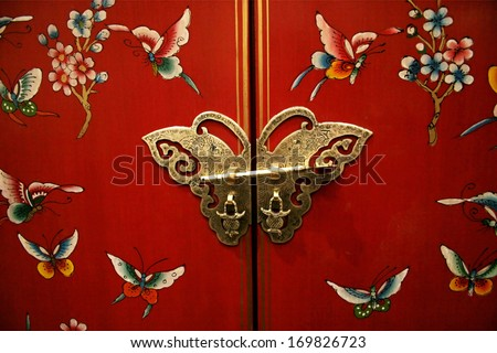 Asian-style door with a butterfly latch. - stock photo