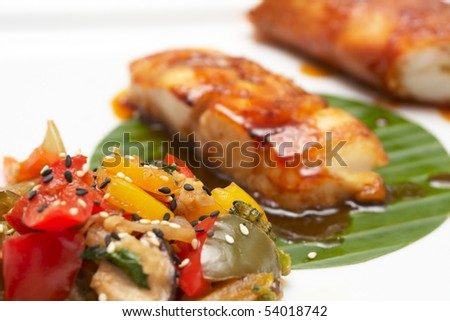 Asian style fried seafood on plate, focus on vegs - stock photo