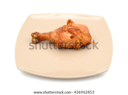 asian style grilled chicken drumstick with fish sauce on plate isolated on white - stock photo
