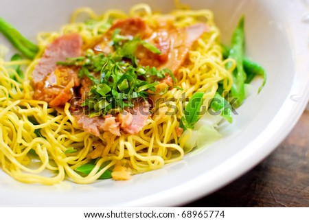 Asian style noodle with pork and vegetables - stock photo