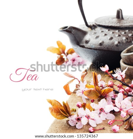 Asian tea pot with cherry blossom isolated over white - stock photo