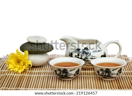 Asian tea set on bamboo mat, Closeup. - stock photo