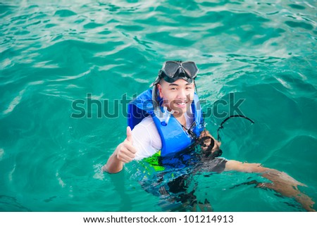 Asian teenager boy diving in sea - stock photo