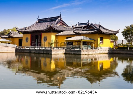 Asian temple by the lakeside - stock photo