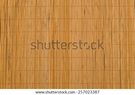 Asian typical bamboo tablecloth in brown. Decorative background - stock photo