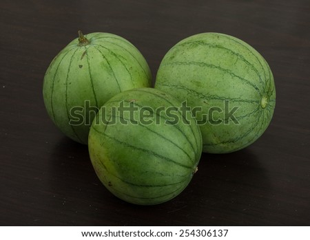 Asian vegetable - round aubergine on the wooden background - stock photo