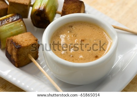 Asian vegetarian skewers made from mushrooms, tofu and leek - stock photo
