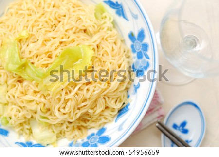 Asian vegetarian yellow noodles with healthy vegetables. Suitable for concepts such as diet and slimming, healthy lifestyle, and food and beverage. - stock photo
