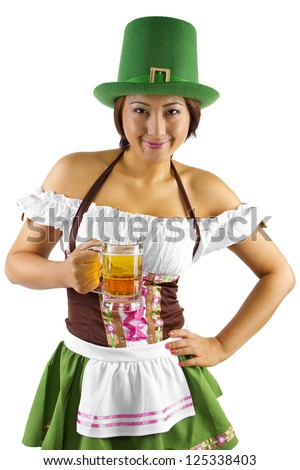Asian waitress in a St Patricks Day costume holding a mug of beer. - stock photo