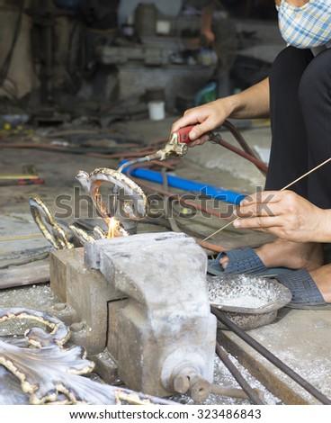 Asian welder making decoration  - stock photo