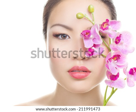 Asian woman beauty face closeup portrait. Beautiful attractive mixed race Chinese Asian / Caucasian female model with perfect skin, manicure and day make up, holding  isolated on white background - stock photo