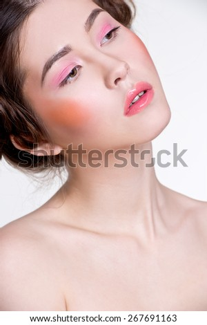 Asian woman beauty face closeup portrait. Beautiful attractive mixed race Chinese Asian / Caucasian female model with perfect skin and pink make up - stock photo