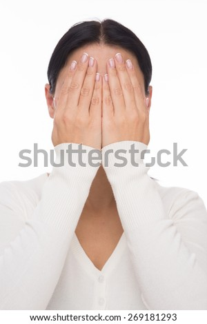 Asian woman closed face with hands isolated on white - stock photo