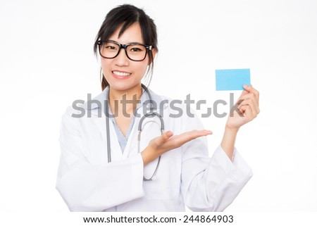 asian woman doctor holding blank card that you can replace with everything - stock photo