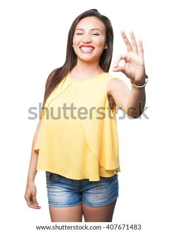 asian woman doing okay gesture - stock photo