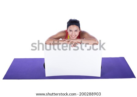 asian woman doing yoga and showing blank signboard isolated on white background - stock photo