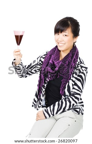 Asian woman drinking wine from purple glass on white background - stock photo