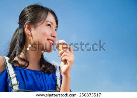 Asian woman  eating ice cream in the summer - stock photo