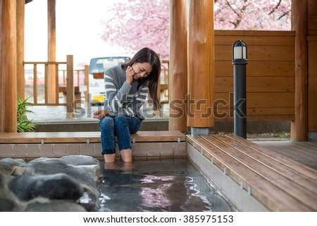 Asian Woman enjoy her foot onsen - stock photo