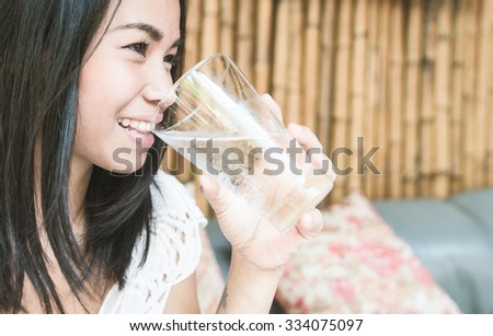 Asian woman holding a glass of water. concept about healthy lifestyle - stock photo