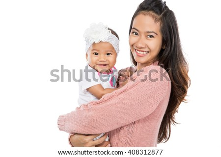 Asian woman holding her baby girl isolated over white background - stock photo