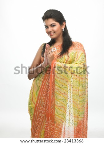 Asian woman in a tradition sari with welcome expression - stock photo